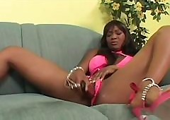 Muddy dark-skinned lesbo masturbated anent fruitful dildo